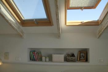 התקנה ואספקה על ידי עליית גג של חלונות וולוקס